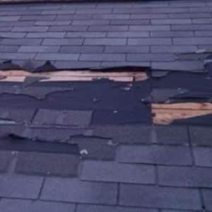 a pic showcasing a damaged shingle roof
