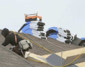a roof replacement specialist is at work
