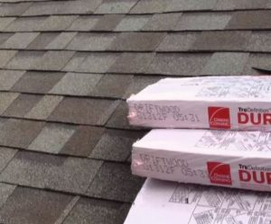 industry trusted roofing shingle brand on top a roof